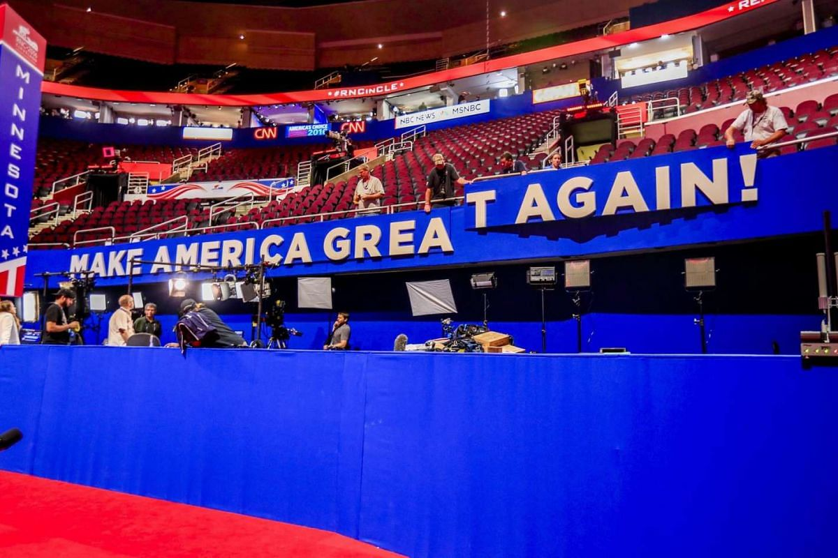 "Workers hang a sign reading ""Make America Great Again!"", the campaign slogan of Donald Trump, inside Quicken Loans Arena in Cleveland, Ohio on July 16, 2016."