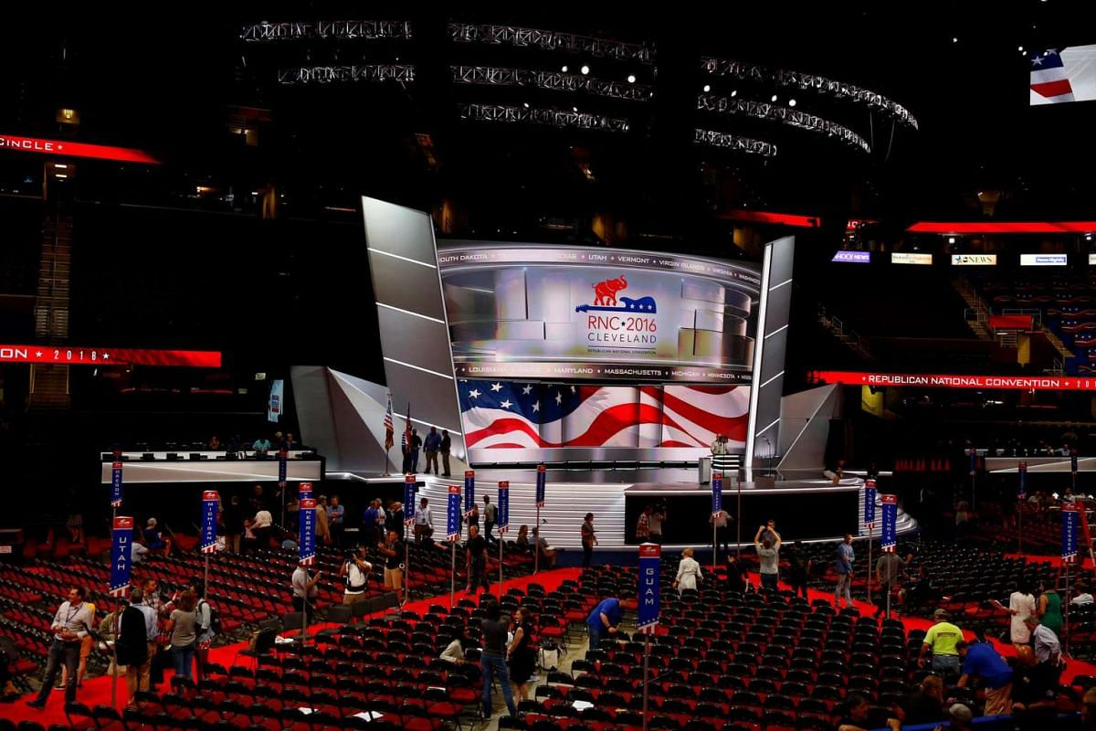 Members of the Committee on Arrangements pose for a photo on the stage at Quicken Loans Arena as setup continues in advance of the Republican National Convention in Cleveland, Ohio on July 16, 2016.