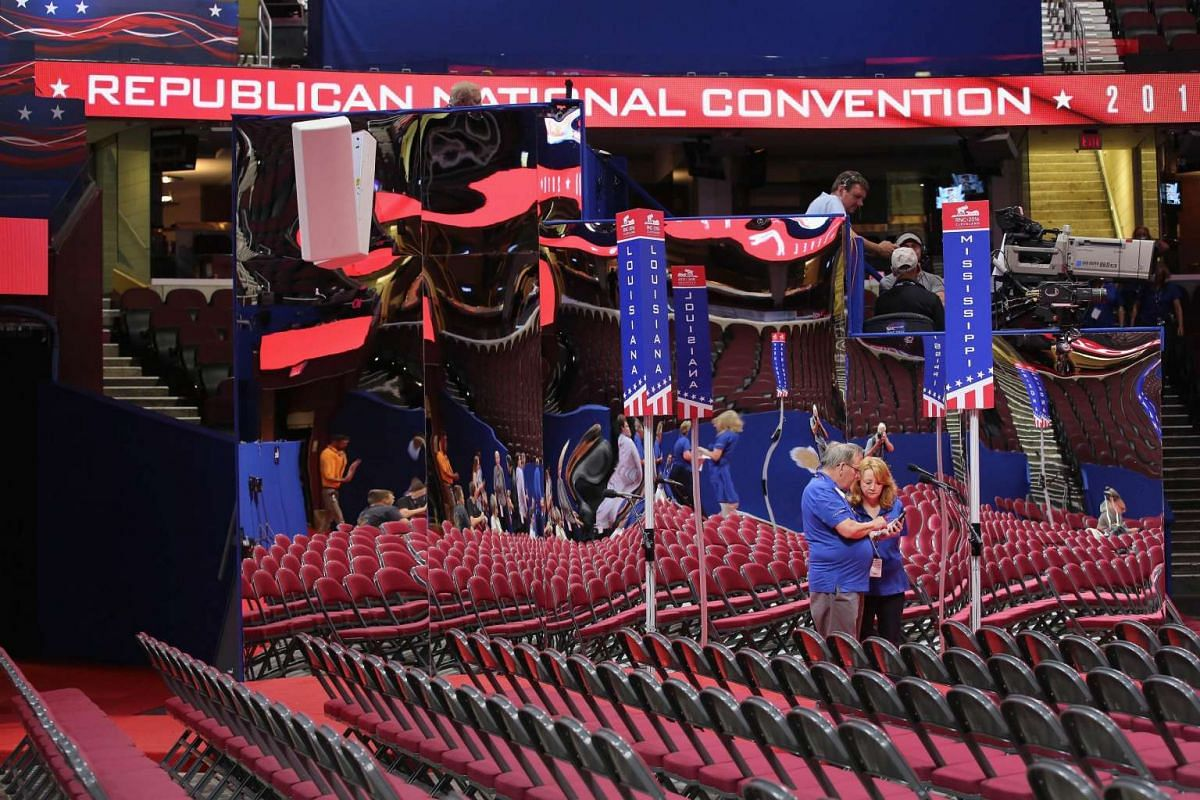 Event workers compare photos on the floor of the Quicken Loans Arena ahead of the Republican National Convention on July 16, 2016 in Cleveland, Ohio.