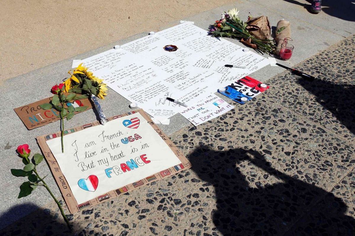 Supporters for the victims of the attack in Nice, France leave flowers and notes during a vigil and moment of silence in San Francisco, California on July 16, 2016.