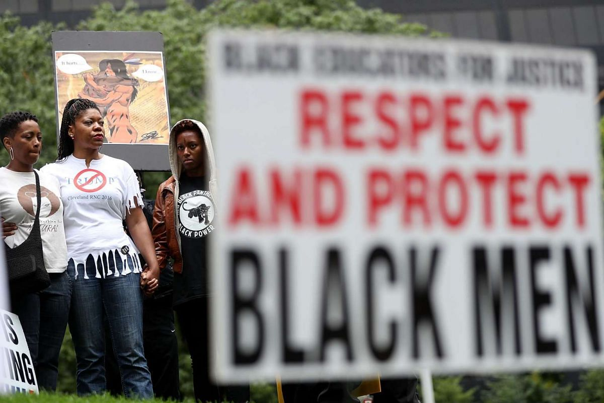 Members of the New Black Panther Party stage a protest near the site of the Republican National Convention on July 16, 2016.