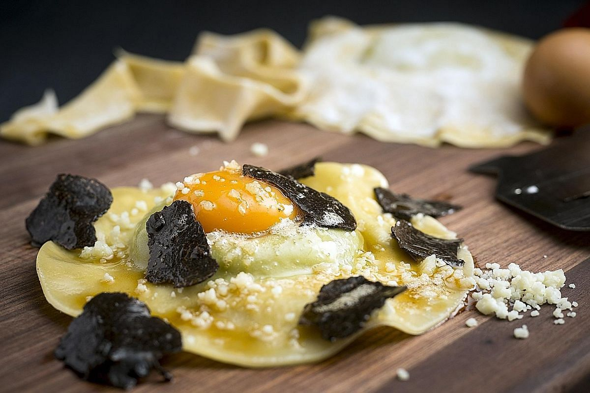 The Tartufo Pizza (above) and the Homemade Raviolo (left).
