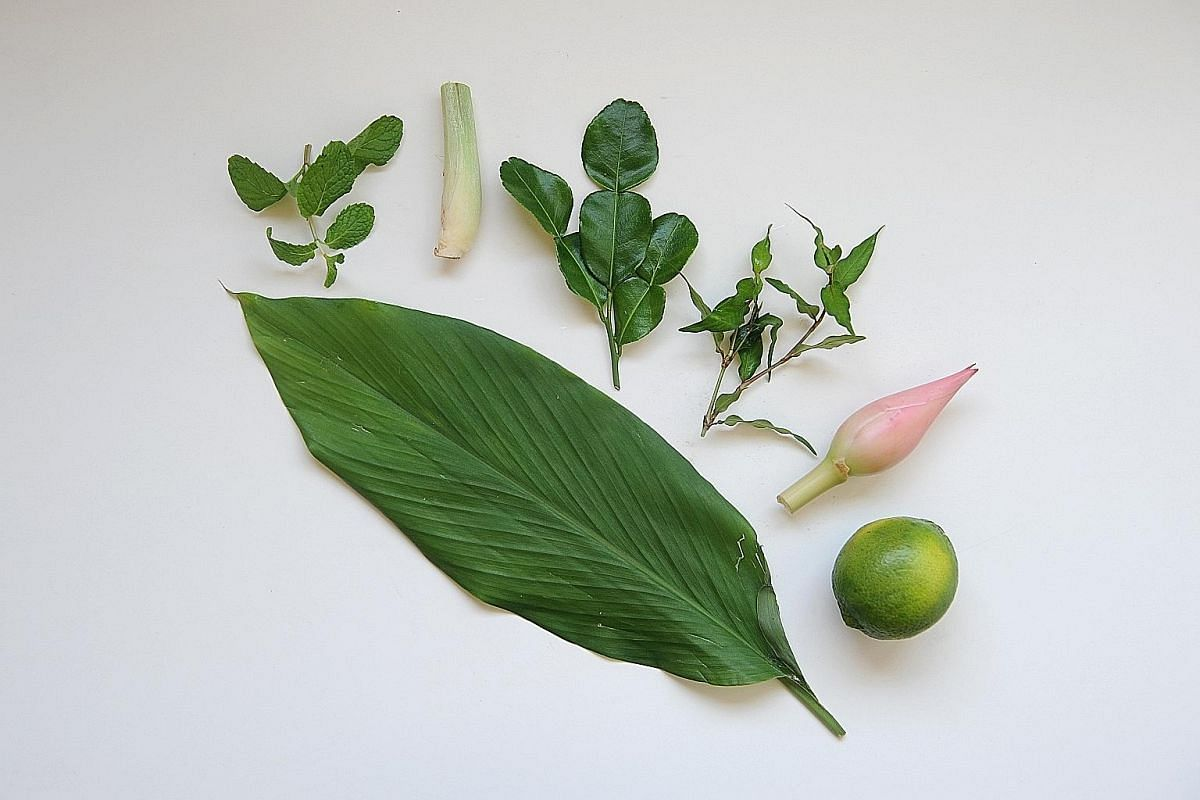 Clockwise from top, far left: mint leaves, lemongrass, kaffir lime leaves, laksa leaves, torch ginger bud, large lime and turmeric leaf. The nutty flavour of brown rice goes well with the aromatic herbs such as bunga kantan and turmeric leaves.