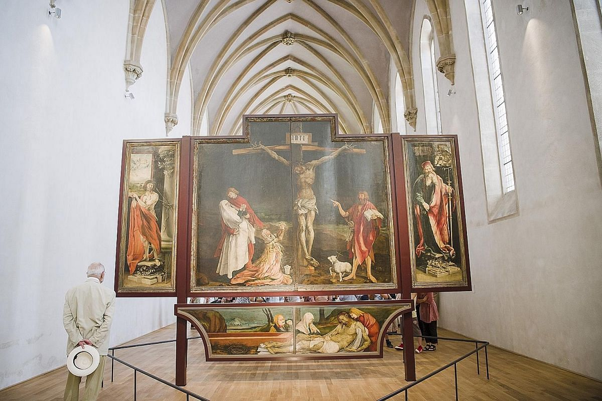 Matthias Grunewald's early 16th-century work, Isenheim Altarpiece, is a major tourist attraction in Alsace. Riquewihr, a picturesque town of half-timbered buildings.
