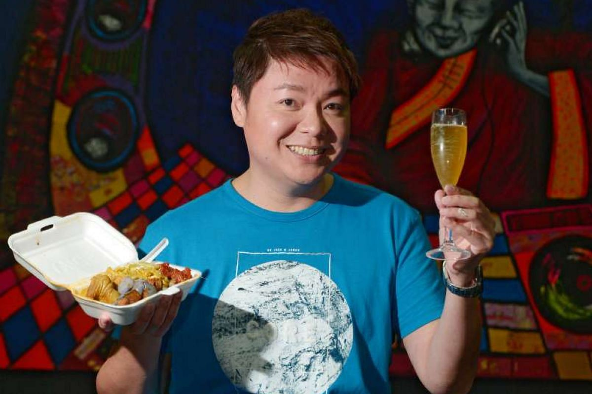 Sebastian Tan indulging in a packet of economy rice and a glass of champagne.
