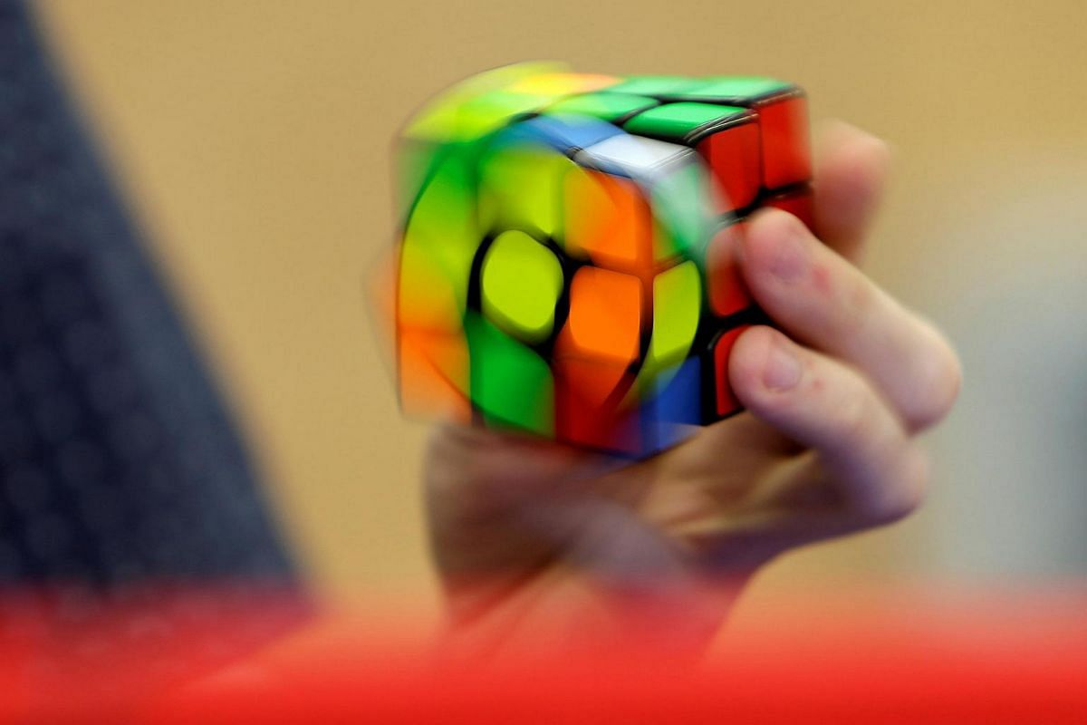 A competitor solves a Rubik's cube using one hand during the Rubik's Cube European Championship in Prague, Czech Republic, on July 17.