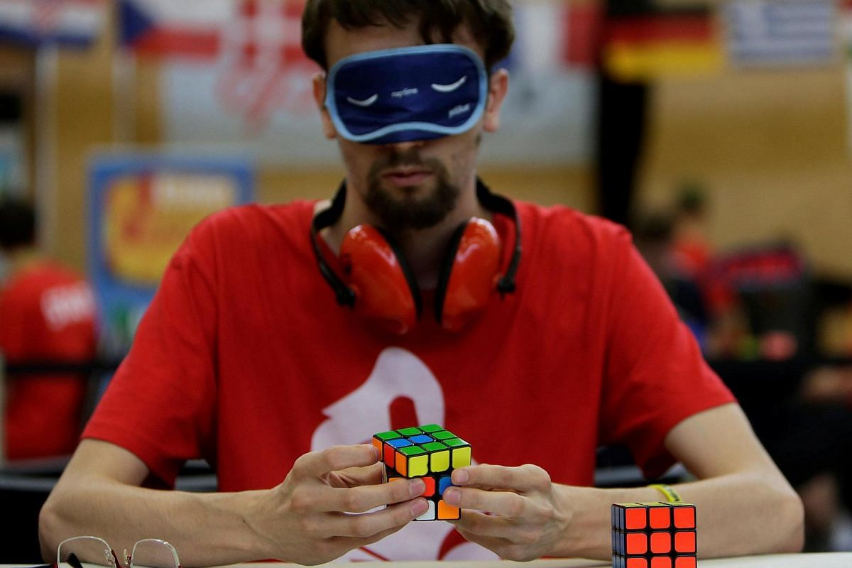 A blindfolded competitor solves a Rubik's cube as he prepares for the Rubik's Cube European Championship in Prague, Czech Republic, on July 15.
