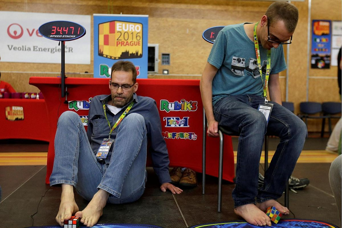 Competitors solve Rubik's cubes using their feet during the Rubik's Cube European Championship in Prague, Czech Republic, on July 15.