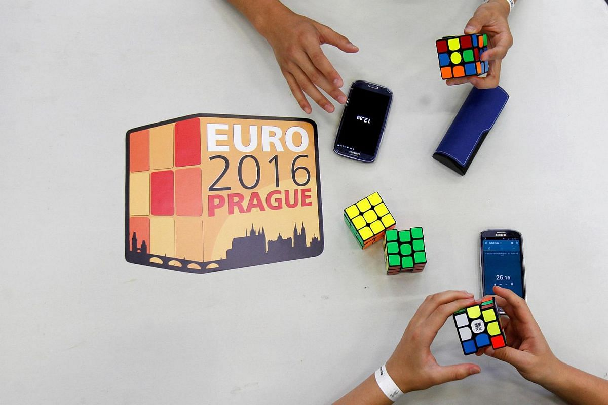 Competitors solve Rubik's cubes as they prepare for the Rubik's Cube European Championship in Prague, Czech Republic, on July 15.