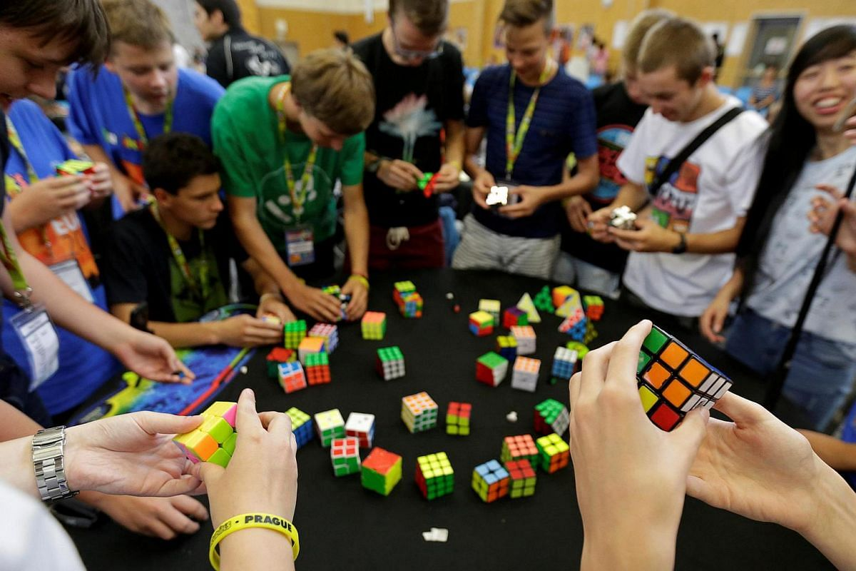 Competitors solve Rubik's cubes as they prepare for the Rubik's Cube European Championship in Prague, Czech Republic, on July 17.