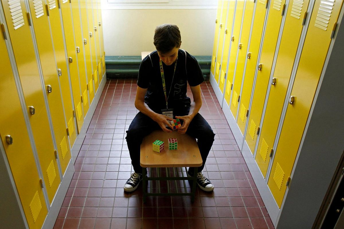 A competitor solves a Rubik's cube as he prepares for the Rubik's Cube European Championship in Prague, Czech Republic, on July 15.