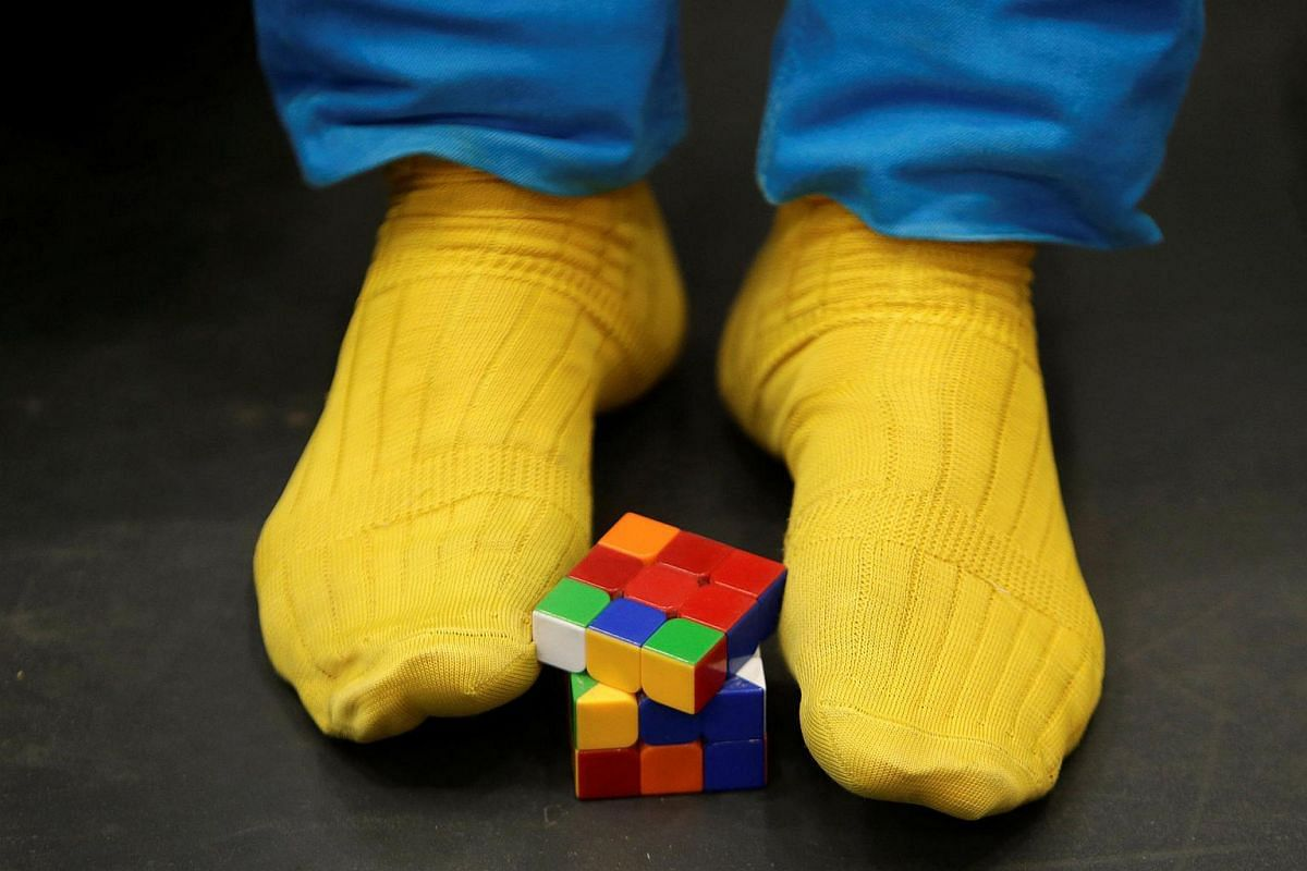 A competitor solves a Rubik's cube using his feet as he prepares for the Rubik's Cube European Championship in Prague, Czech Republic, on July 15.