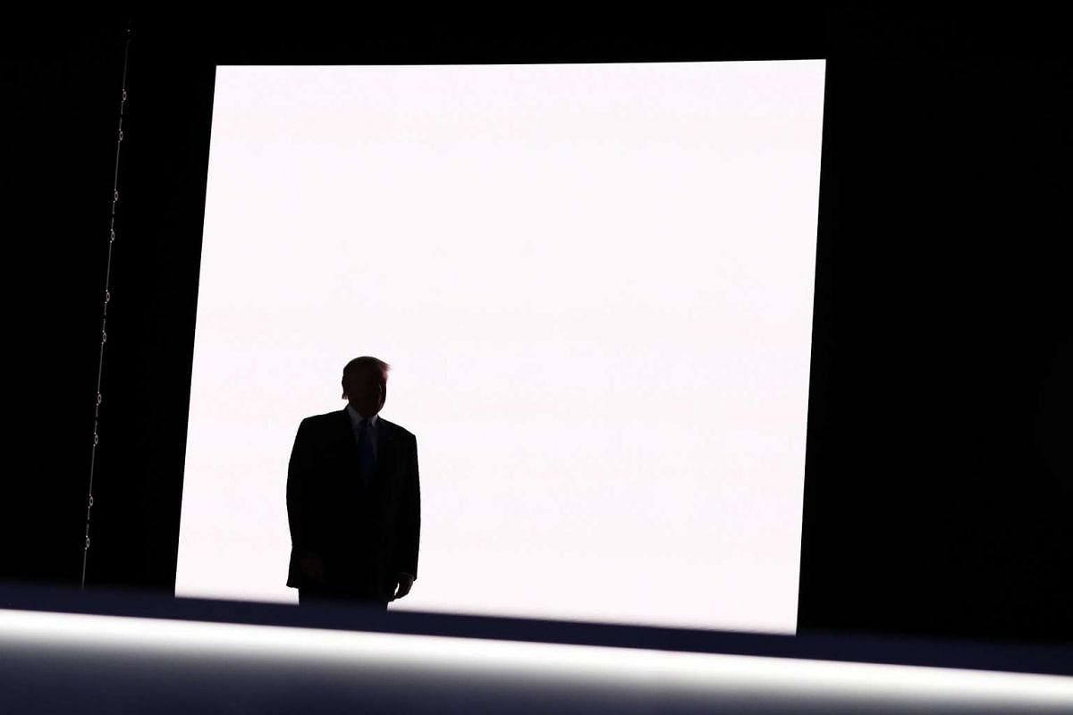 Presumptive Republican presidential nominee Donald Trump walks on stage to introduce his wife Melania on the first day of the Republican National Convention on July 18, 2016, at the Quicken Loans Arena in Cleveland, Ohio. An estimated 50,000 people a