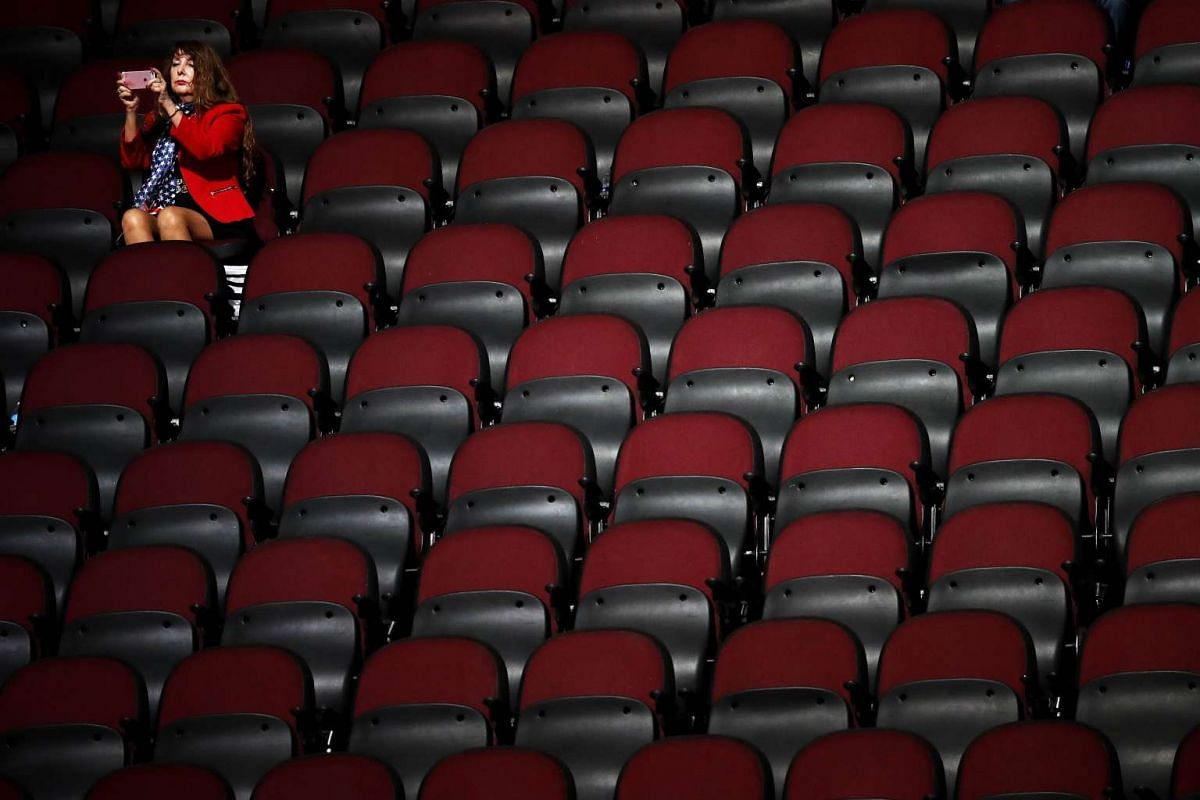 An attendee takes a picture on the first day of the Republican National Convention on July 18, 2016 at the Quicken Loans Arena in Cleveland, Ohio.
