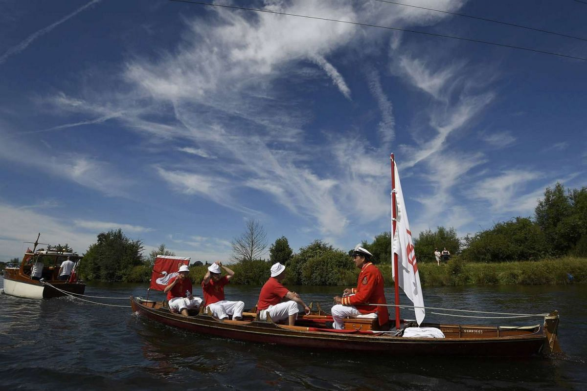 A boat crew rowing along the River Thames, during the annual Swan Upping census,  near Shepperton in southern England, on July 18, 2016.