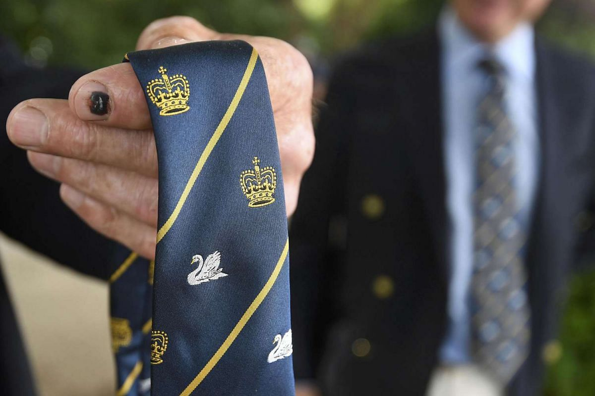 An official showing the swan and crown motifs embroidered on his tie, during the annual Swan Upping along the River Thames, on July 18, 2016.