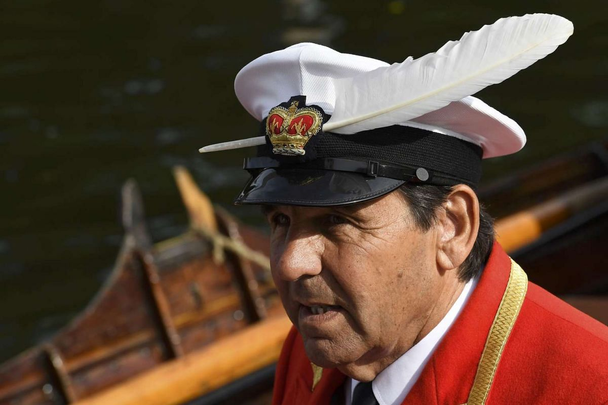 Mr David Barber, The Queen's Swan Marker, prepares to set off for Swan Upping along the River Thames, on July 18, 2016.
