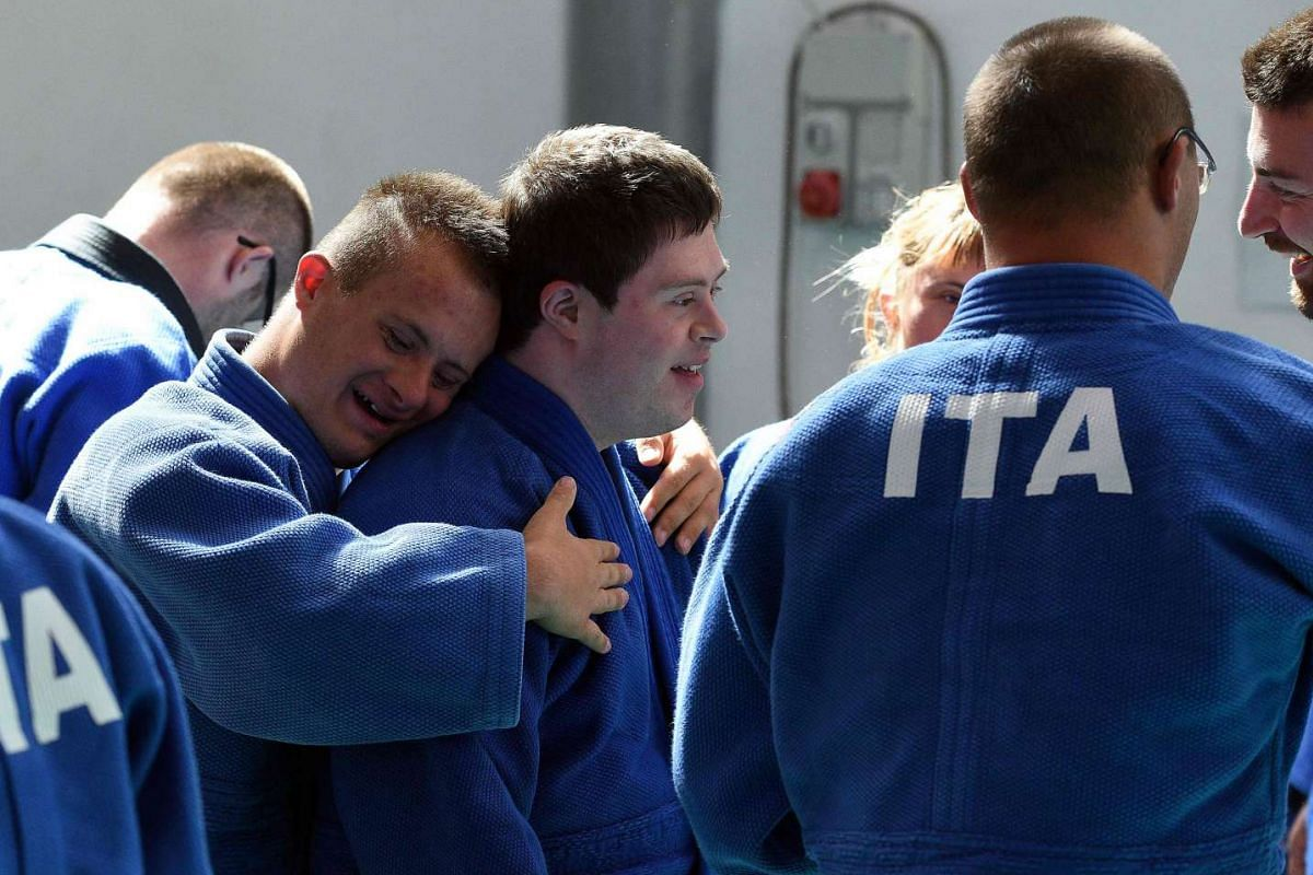 Italian atheletes react in Florence during the first World Trisome Games, dedicated exclusively to athletes with Down syndrome on July 18, 2016.