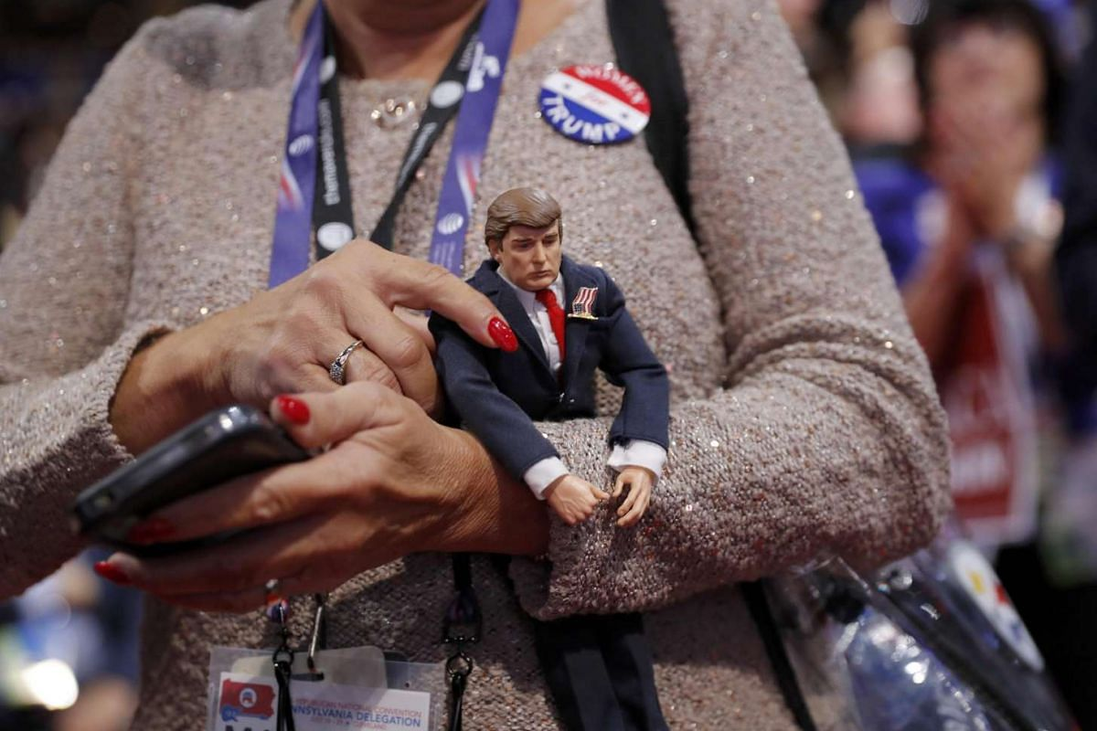 A delegate holds a Donald Trump doll during the second day of the Republican National Convention in Cleveland, Ohio, on July 19.