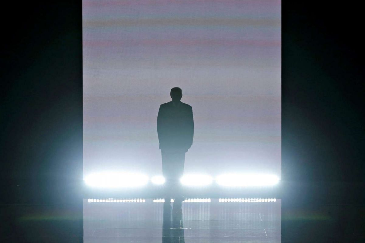 Republican US presidential candidate Donald Trump appears onstage in a blaze of lights at the Republican National Convention in Cleveland, Ohio, on July 18.