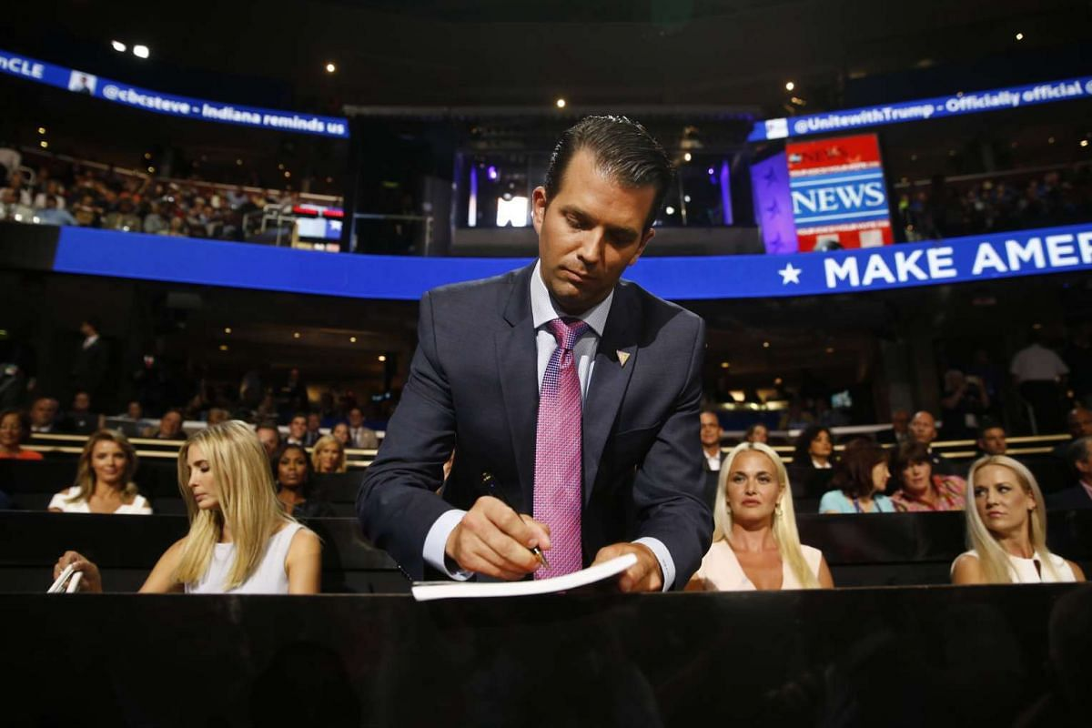 Donald Trump Jr., son of Republican Presidential Nominee Donald Trump, makes a note, with his sister Ivanka Trump (left), during the Republican National Convention in Cleveland, Ohio, on July 19.