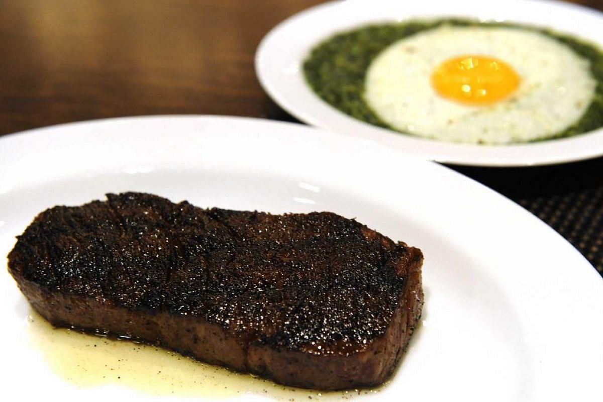 American Kobe style sirloin with creamed spinach and fried organic egg from Cut, a restaurant by celebrity chef Wolfgang Puck at Marina Bay Sands Hotel.