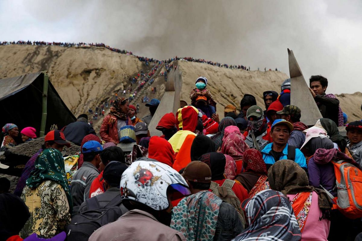Mount Bromo spews ash as Hindu villagers and visitors gather ahead of Kasada ceremony, when worshippers throw offerings such as livestock and other crops into the volcanic crater of Mount Bromo, in Probolinggo, Indonesia on July 20, 2016.
