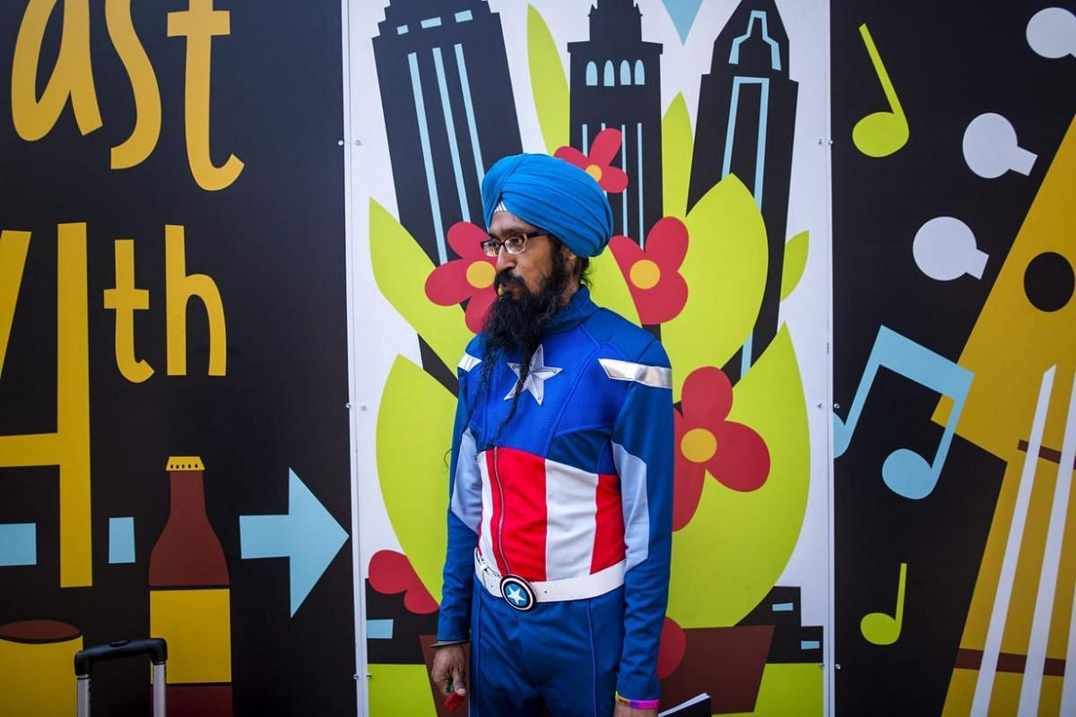 Vishavjit Singh watches protestors come and go near the Quicken Loans Arena on the third day of the Republican National Convention in downtown Cleveland, Ohio, US, on 20 July.
