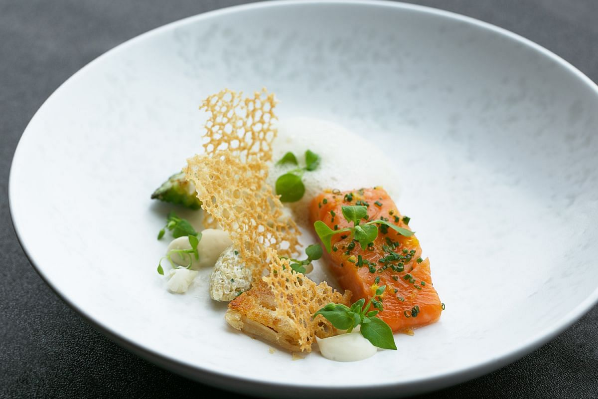 Silky smooth rainbow trout confit, lemony quinoa and creamy cauliflower mash with a crispy chicken skin tuille from Jaan.