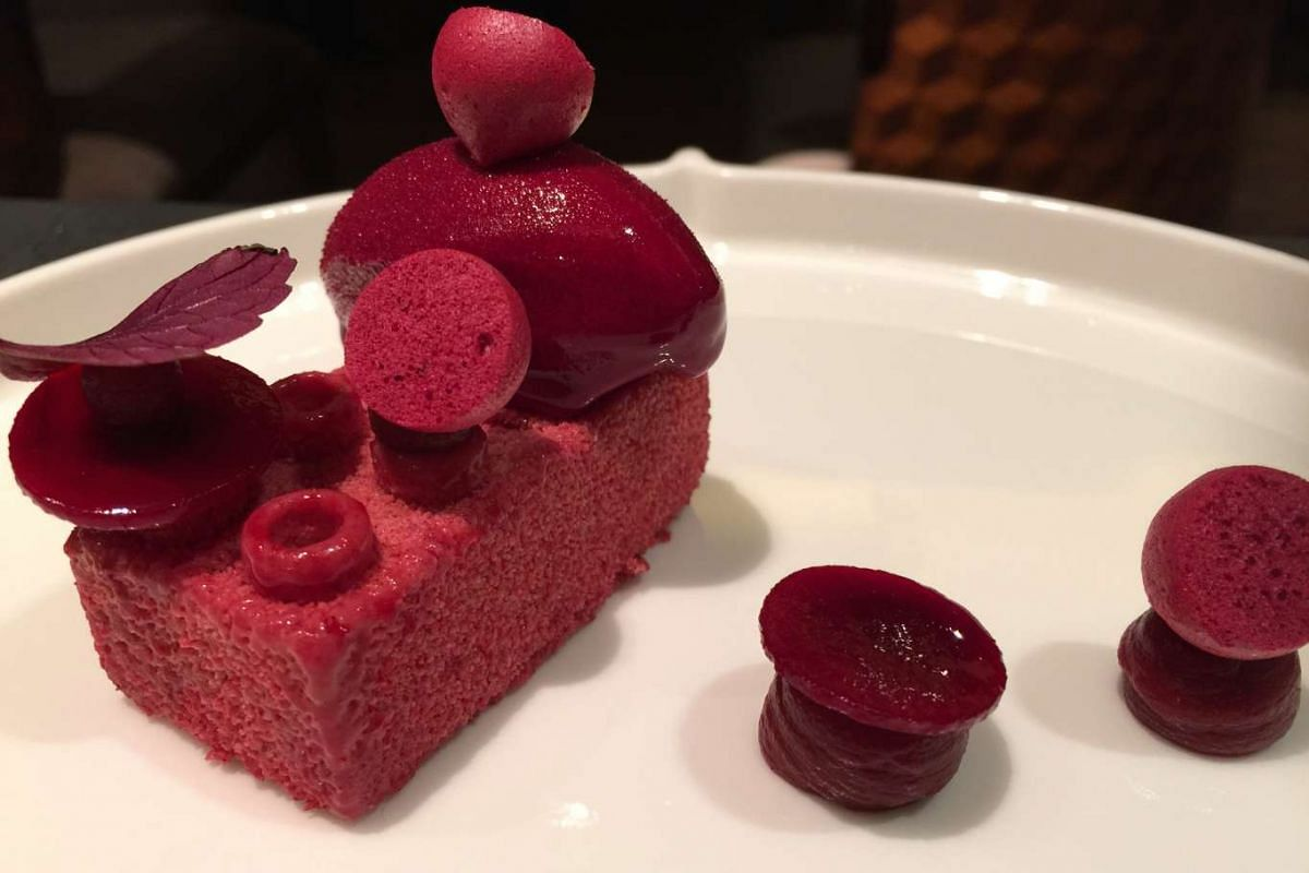 Brick in the Wall, a milky ice cream infused with cardamom and cinnamon and coated in beetroot syrup from Alma restaurant at Goodwood Park Hotel.
