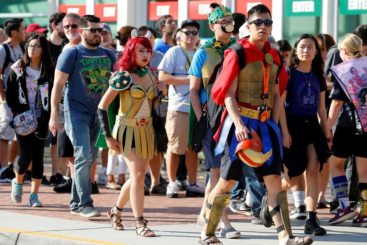 Fans of superhero movies, comic books and pop culture arrive in costume for opening day of the annual Comic-Con International in San Diego, California.