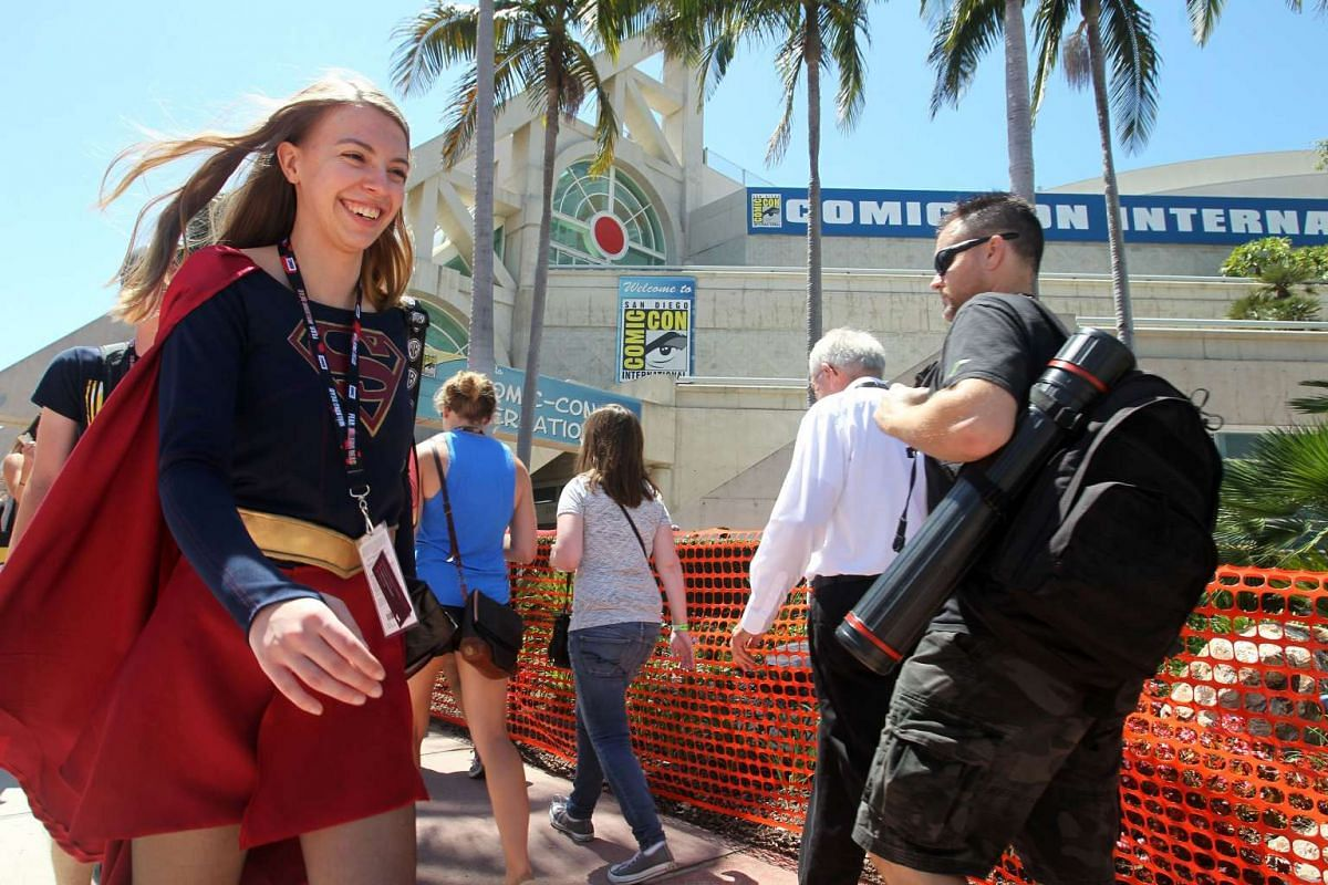 Tyler Greening of Albuquerque, New Mexico, USA, dressed as Supergirl, careens past the San Diego Convention Center where the Comic-Con International 2016 is being held in San Diego, California on July 21.