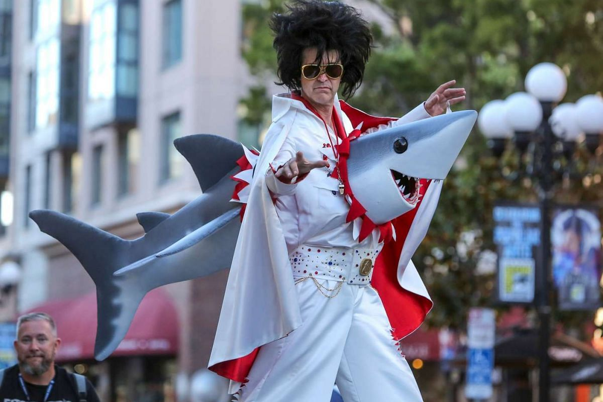 An Elvis impersonator performs on stilts promoting the movie Sharknado during Comic-Con International 2016 in San Diego, California on July 21.