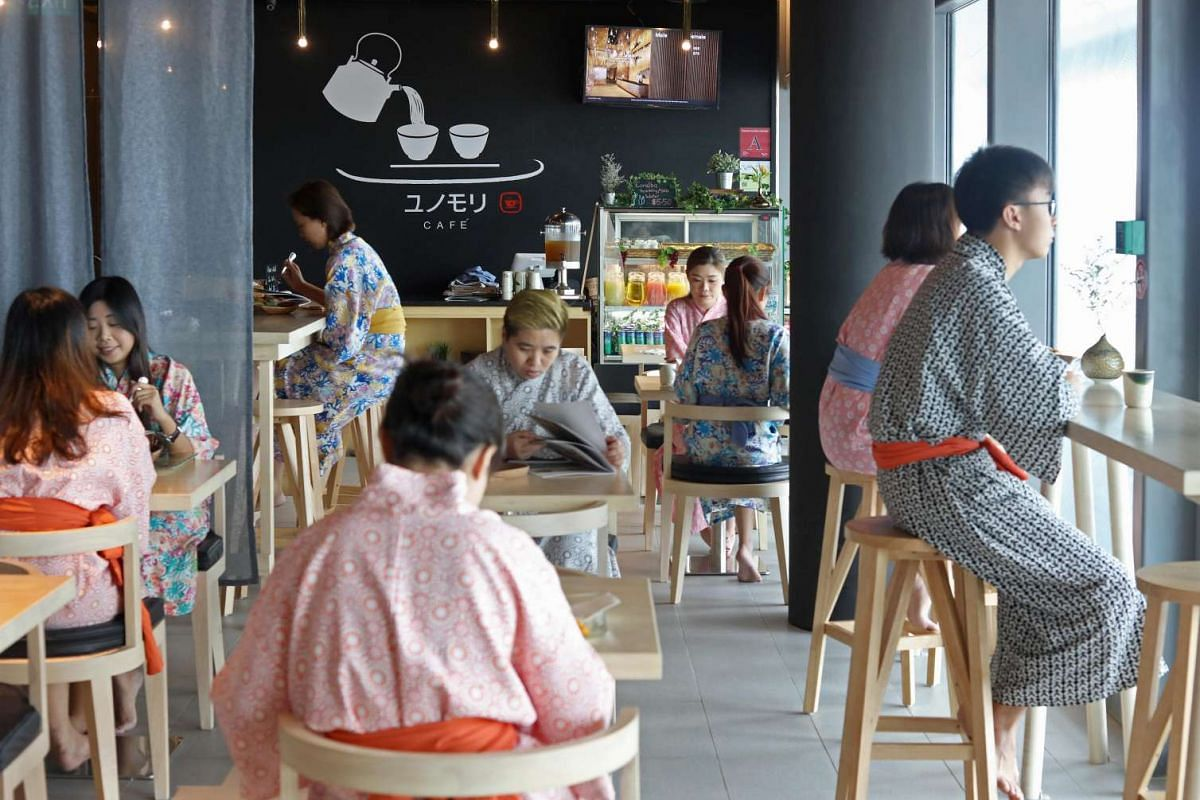 Diners dressed in Yukata robes at the cafe and dining area at Yunomori Onsen & Spa.