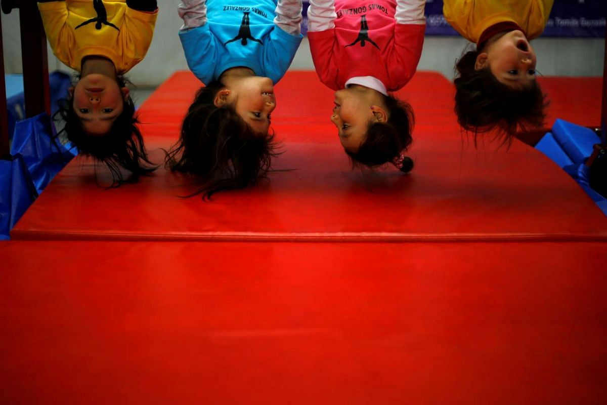 Children train during a practice session at the school-gym of Tomas Gonzalez, the first Chilean gymnast to qualify twice for the Olympics, in Santiago, Chile on July 20, 2016.