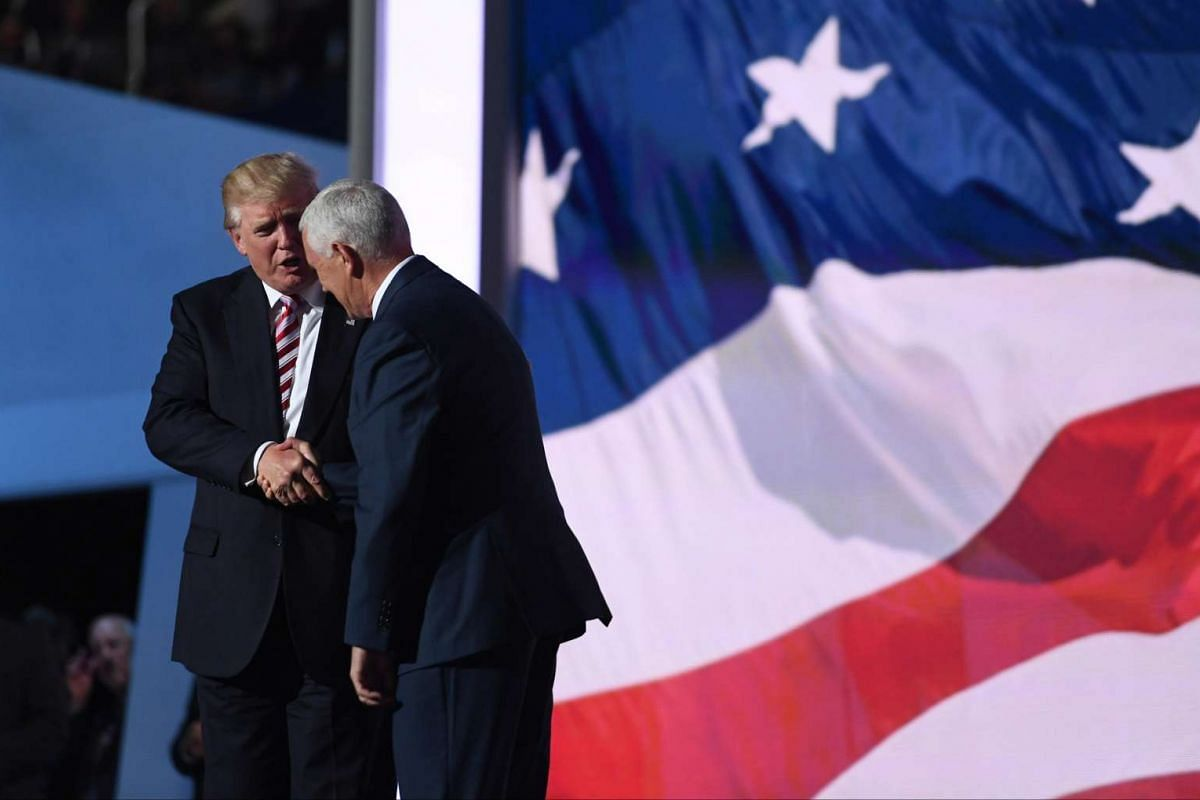 Indiana Gov. Mike Pence is greeted by his running mate, Republican presidential nominee Donald Trump, during the third day of the Republican National Convention on July 20.