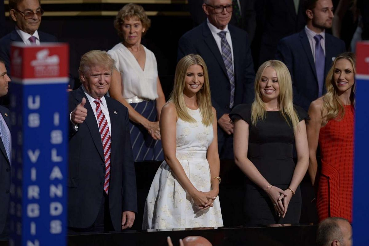 Republican presidential candidate Donald Trump (second, left) stands with his son Donald Trump Jr. (left), daughters Ivanka Trump (center) and Tammy Trump (second, right), and daughter-in-law Lara Yunaska (right) during the third evening session of t