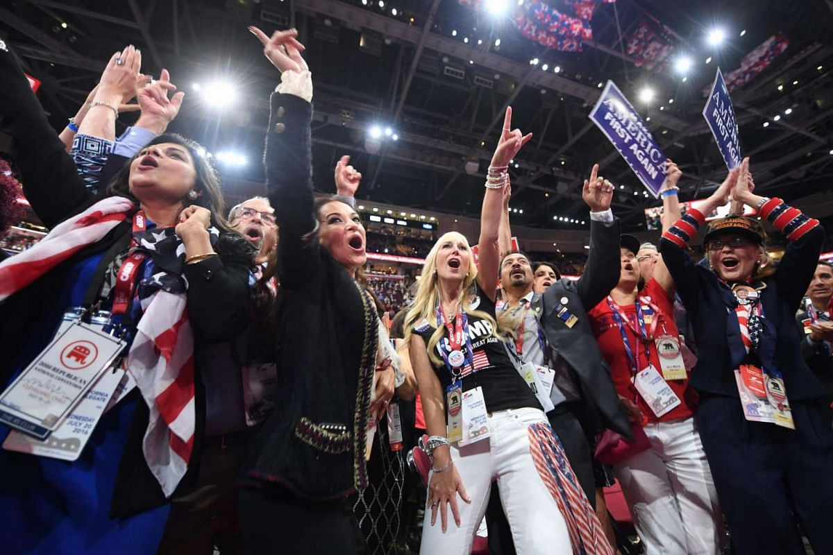 Delegates cheer on the floor of the Republican National Convention at Quicken Loans Arena in Cleveland, Ohio on July 20.
