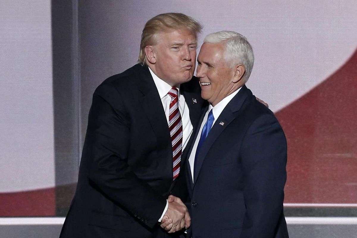 Republican presidential nominee Donald Trump (left) greets vice presidential nominee Mike Pence after Pence spoke during the third day of the Republican National Convention in Cleveland, Ohio on July 20.