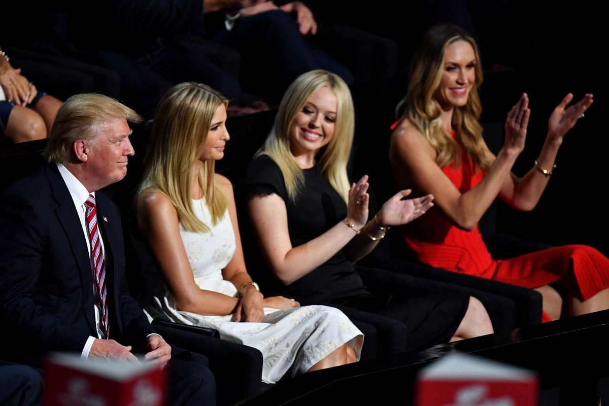 (From left to right) Republican presidential candidate Donald Trump, Ivanka Trump, Tiffany Trump and Lara Yunaska attend the third day of the Republican National Convention on July 20 at the Quicken Loans Arena in Cleveland, Ohio.