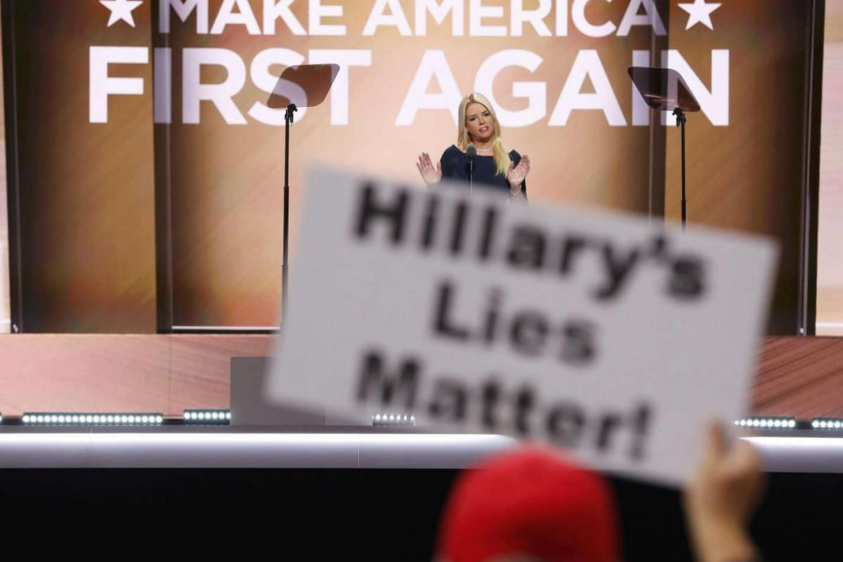 A delegate holds up a 'Hillary's Lies Matter' sign as Florida Attorney General Pam Bondi addresses the third session of the Republican National Convention in Cleveland, Ohio on July 20.