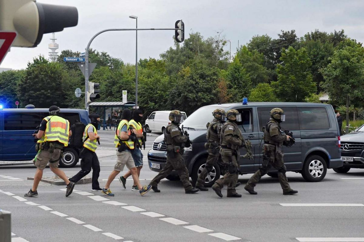 Special police forces rush to the scene at a shopping centre where a shooting was taking place in Munich, Germany on July 22.