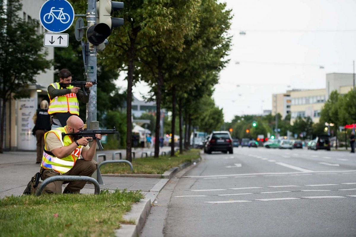 Police secures an area in Munich on July 22 following a shooting earlier at a shopping mall.