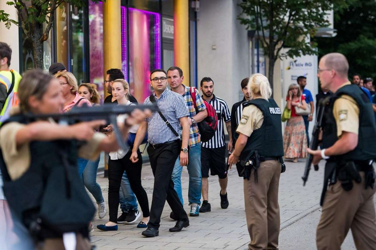 Police evacuates people from the shopping mall in Munich on July 22 following a shooting earlier.