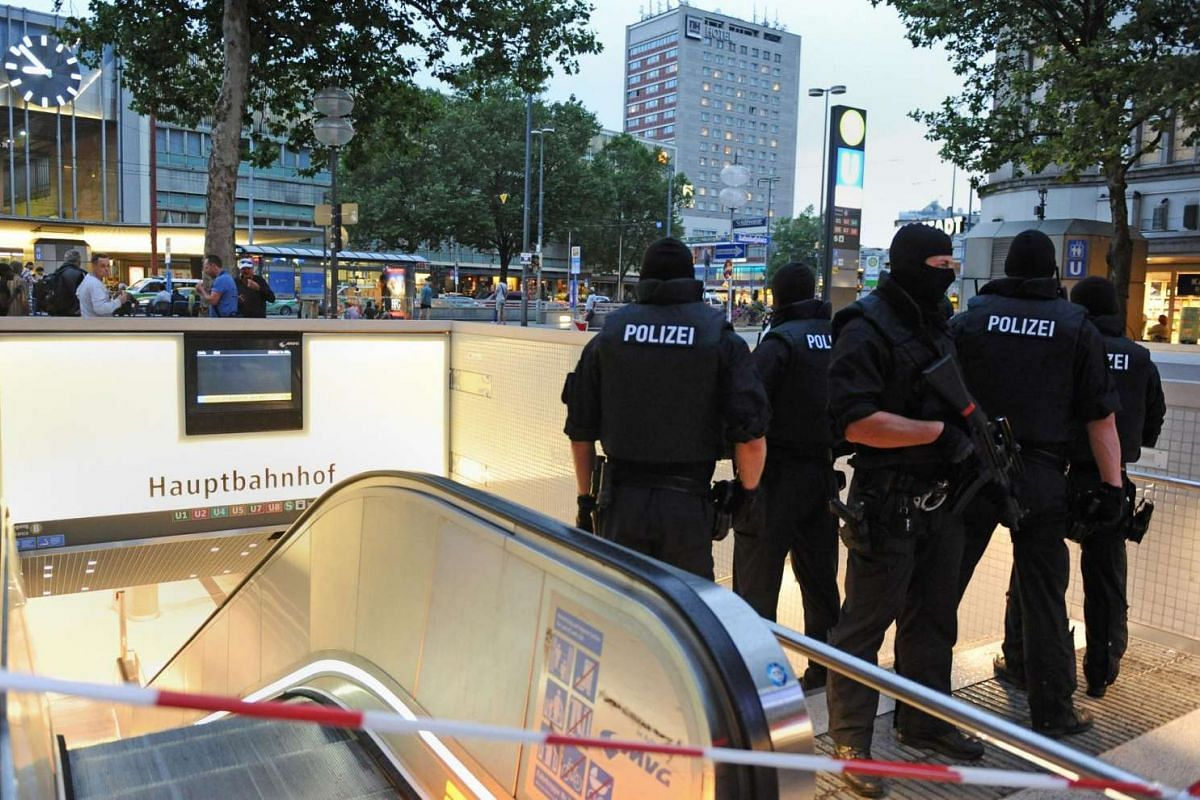 Special police forces stand by the entrance to the subway station of the main train station following shootings at a shopping mall earlier on July 22 in Munich.