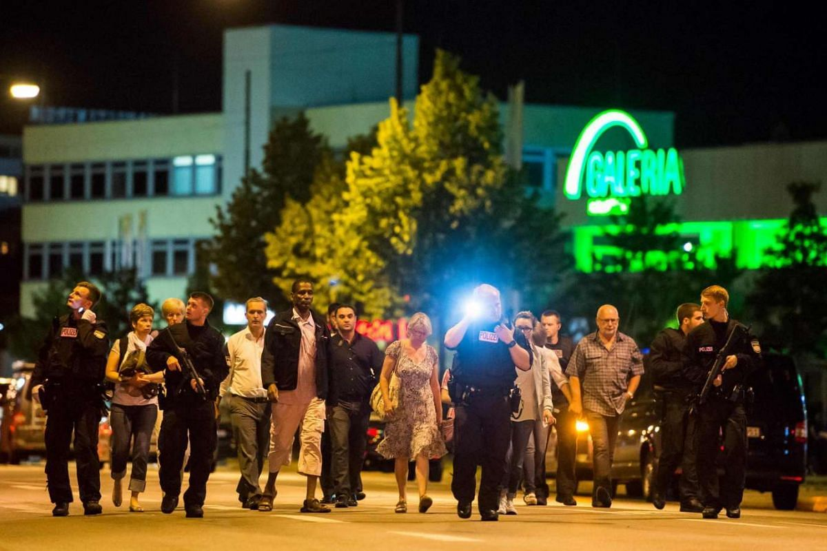 People are evacuated from the area around the shopping mall Olympia Einkaufzentrum OEZ in Munich on July 22 after gunmen went on a shooting rampage in the busy shopping centre, killing eight people in a suspected terror attack.