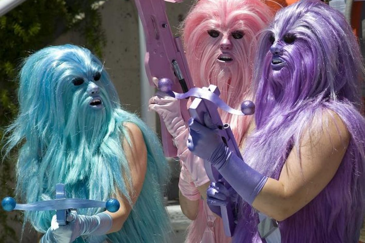 Convention goers dressed as bright colored Wookiees, a fictional species from the US epic space opera franchise Star Wars, prepare for a group photo outside the Comic Con 2016 in San Diego, California, US, 22 July.