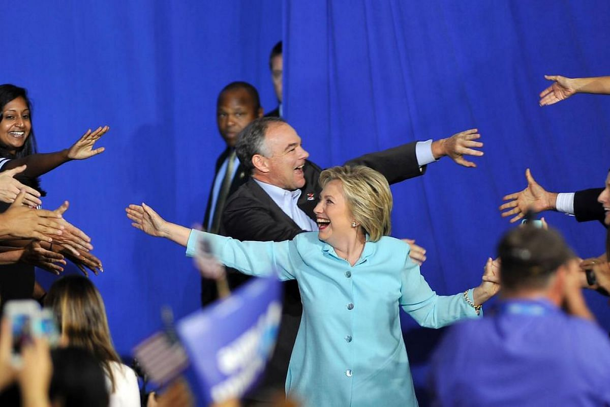 US Democratic Presidential candidate Hillary Clinton and running mate US Senator Tim Kaine arrive for a campaign rally at Florida International University in Miami on July 23