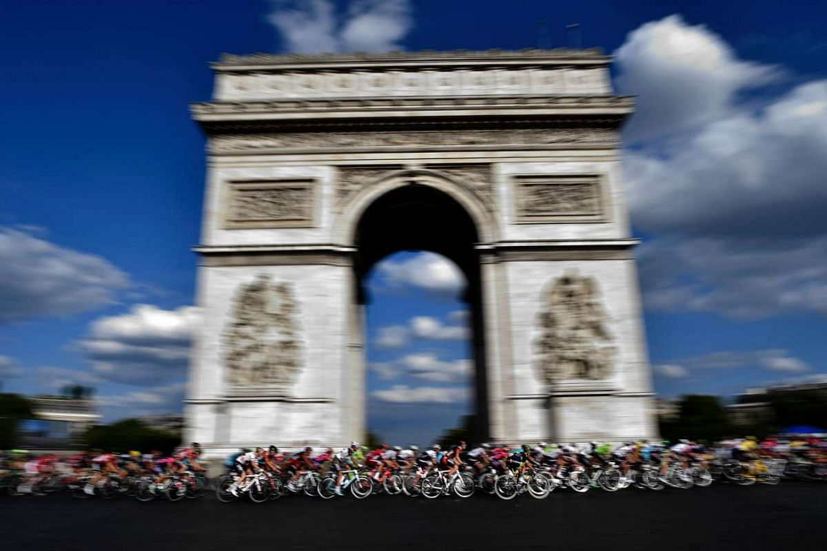The pack rides in front of the Arc de Triomphe (Arch of Triumph) during the 113km, 103rd edition of the Tour de France cycling race on July 24.