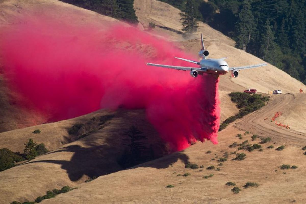 A plane drops fire retardant while battling the Soberane Fire in Carmel Highlands, California on July 23.  The fire has scored more than 10,000 acres and threatens 1,650 structures according to Cal Fire.